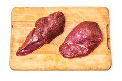 Uncooked Kangaroo meat steaks on cutting board Royalty Free Stock Photos