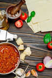 Uncooked lasagna pasta sheets and bolognese sauce Stock Photo