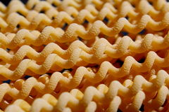 Uncooked long fusilli pasta Stock Images