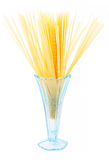 Uncooked long pasta spaghetti macaroni in blue glass vase Royalty Free Stock Photography