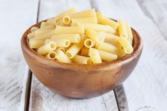 Uncooked macaroni bowl Stock Photos