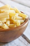 Uncooked macaroni bowl Royalty Free Stock Photo