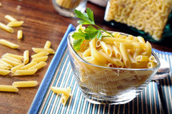 Uncooked macaroni composition in a glass bowl Stock Photography