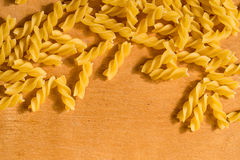 Uncooked macaroni in a form of spiral Stock Photography
