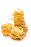 Uncooked macaroni over the white background Stock Images