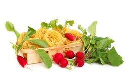 Uncooked macaroni and radish royalty free stock photos