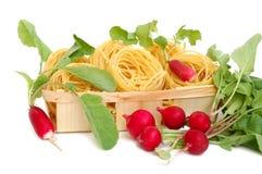 Uncooked macaroni and radish royalty free stock photography
