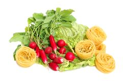 Uncooked macaroni, radish and chinese lettuce leav Stock Photo