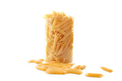 Uncooked macaroni,  on a white background. Pasta in a transparent glass. Typical Italian food pasta in a glass. Royalty Free Stock Image