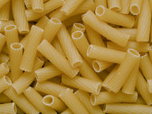 Uncooked maccheroni pasta tubes food texture background Royalty Free Stock Image