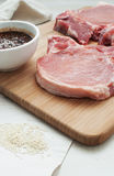 Uncooked meat pieces with sauce and sesame seeds Royalty Free Stock Images