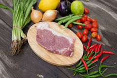 Uncooked meat raw fresh beef ready to cooking with onions parsle Stock Photo