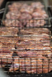 Uncooked meat steak in grilled barbecue Stock Photography