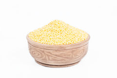 Uncooked millet in a dish Stock Photography
