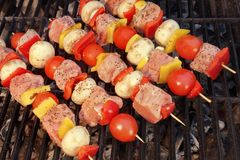 Uncooked Mixed Pork Meat And Vegetables Kebabs On The Grill. Uncooked Mixed Pork Meat And Vegetables Kebabs On The Hot Barbecue Charcoal Grill Royalty Free Stock Image