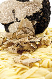 Uncooked Noodles with Sliced Truffles Stock Photo