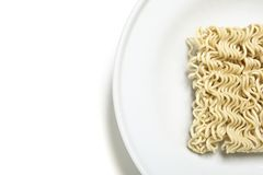 Uncooked noodles on a plate Royalty Free Stock Photo