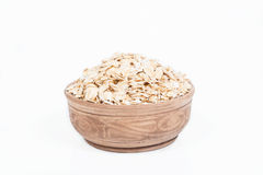 Uncooked oat in a dish Royalty Free Stock Images
