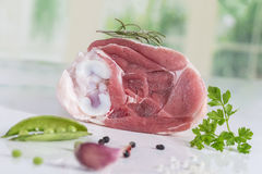 Uncooked organic hock of lamb meat in kitchen. Uncooked organic hock pf lamb meat isolated stock photos