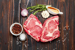 Uncooked organic shin of beef meat. On wooden table Stock Image