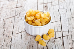 Uncooked pasta in a bowl Royalty Free Stock Image