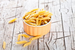 Uncooked pasta in a bowl Stock Photo