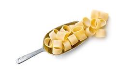 Uncooked pasta calamarata in metal scoop Stock Images