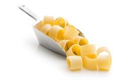 Uncooked pasta calamarata in metal scoop Royalty Free Stock Photography