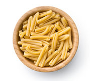 Uncooked pasta caserecce in bowl Stock Images
