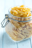 Uncooked pasta caserecce in jar Royalty Free Stock Photos