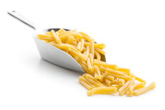 Uncooked pasta caserecce in metal scoop Stock Photography