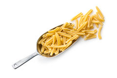 Uncooked pasta caserecce in metal scoop Royalty Free Stock Image