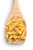 Uncooked pasta caserecce in wooden spoon Stock Image