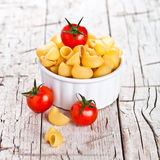 Uncooked pasta and cherry tomatoes in a bowl Royalty Free Stock Photo