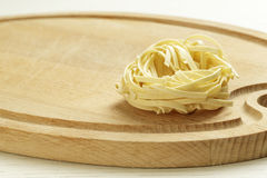An uncooked pasta on a chopping board Stock Images
