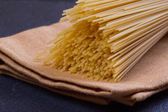 Uncooked pasta on a cloth Royalty Free Stock Images
