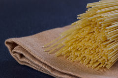 Uncooked pasta on a cloth Stock Photo