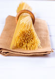 Uncooked pasta on a cloth Stock Image