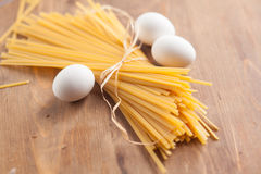Uncooked pasta with eggs Stock Photography