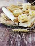 Uncooked pasta with flour on the table, selective focus Royalty Free Stock Image