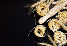 Uncooked pasta with flour on the table, selective focus Stock Photos