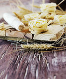 Uncooked pasta with flour on the table, selective focus Stock Photography