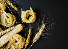 Uncooked pasta with flour on the table, selective focus Stock Image