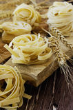 Uncooked pasta with flour on the table, selective focus Stock Images
