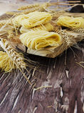Uncooked pasta with flour on the table, selective focus Royalty Free Stock Photos