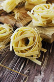 Uncooked pasta with flour on the table, selective focus Royalty Free Stock Images