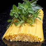 Uncooked Pasta with Fresh Herbs Stock Photo