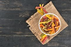 Colorful fusilli pasta in bowl Stock Images