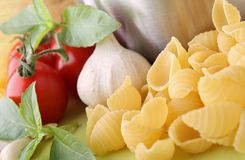 Uncooked pasta and ingredient Stock Photos