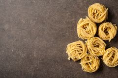 Uncooked pasta on kitchen table. Copy space royalty free stock photos